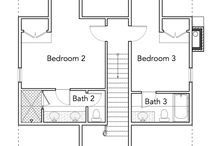 Ralston Creek / The Ralston Creek plan is a crawl space design with a side parking bay. Though quaint, it features an open living/kitchen/dining area and his and her closets.