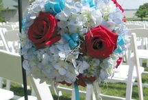 A wedding of Red & Blue / Brides sometimes like to walk on the wide side with color mashups. This bride really focused on red and used white, light blue and aqua to show it off. It can have a very dramatic effect.