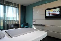 Guest Rooms / Post-Hotel Wuerzburg offers modern comfortable rooms, furnished with care and attention to detail, featuring large LCD TV and Wi-Fi. The bathroom is fitted with a bathtub or a tub shower. Breakfast costs 9.90 euro.