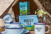 Take Your Caddy Camping / We love time in the great outdoors at Dorset Tea! We're thrilled that it's time to dust off our camping gear and go off on an adventure. This year we'll be joined by our gorgeous new caddy and enamel camping ware. You can win these by entering our competition on line at www.dorsettea.co.uk - you can also buy our caddies and cups here. Happy summer adventures.