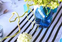 Elekta Corporate Dinner / Elekta's Corporate dinner was styled with a bold and modern twist using the company brand of blue and lime green, our floral artisans kept with a minimalist vibrant pop of green orchids and coloured branches in elegant cobalt blue vases. Black and white striped satin runners lifted the tablescape whilst complimented by Silver beaded charger plates and green napery. Frosted blue tealight votives added ambience to the occasion. Youtube: https://www.youtube.com/watch?v=6yoZ3LBdngQ&feature=youtu.be