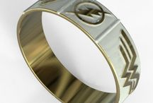 Superhero Wedding Bands / These are various examples of superhero wedding bands. The logos can be customized: Superman, Batman, Wonder Woman, Flash, Green Lantern, Avengers, Spiderman, Deadpool and many others