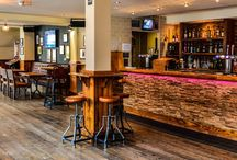 The Coach & Horse / The Coach and Horses, designed by Innex Design, used our Stage Pine for the flooring of this bar to add a rustic feel.