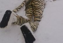 snow tiger / post-apocalyptic background, snow, plush tiger