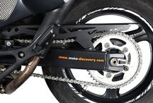 Motorcycle chain guards and huggers