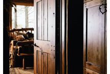 """Rustic Doors / Incorporating many elements found in nature, Rustic homes (sometimes called """"Mountain"""" homes) embody the simplicity and beauty of the great outdoors. Exteriors often feature timber or stone siding, blending with the outside environment. Interiors accent wood-beamed ceilings, grand stone fireplaces, wide plank hardwood flooring and doors and mouldings made with knotty or """"character"""" woods. These Rustic elements provide an atmosphere of easy relaxation."""
