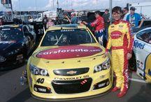 Landon Cassill / NASCAR Sprint Cup Series driver Landon Cassill and the No. 40 Carsforsale.com Car.