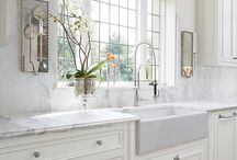Big kitchen window with white basin