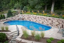 Pool Landscaping Ideas / With Rosetta Hardscapes, it's easy to imagine kicking back to relax by the pool. Whether you want an elegant grotto, a place off which the kids can perfect their cannonballs, or just a poolside perch for some lounge chairs, these top 15 pool landscaping ideas will spark your imagination.