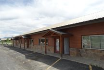 953 Park Avenue, Pagosa Springs, CO 81147 / Listing Broker - Shelley Low This building is extremely versatile. It can be used as a single warehouse, workshop or 4 separate offices. The office on the far east side use to be a lighting store while the unit on the west side has a tall overhead door which is ideal for a warehouse and more. Paved road, paved parking lot and great location close to all other amenities makes this a great property at a great price.