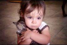 The girl likes her kitty