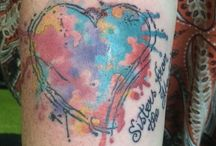 Water colour heart sister tattoo