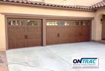 Faux Wood Garage Doors / Faux wood garage doors are steel garage doors that look like wood grain.  They are very popular in Southern California because they don't rot or deteriorate in the sun or near the beach.  They give you the beauty of a custom wood garage door without the maintenance or refinishing.  Check out ontracdoors.com for more info about our faux wood garage doors!