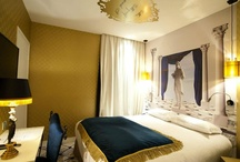 """L'Orgueil Room - 213 rue Croix Nivert, Paris 01 55 76 55 55 / Pride : The rooms offer elegant and majestic palaces adorned with statues and marble columns , where the deep blue is accented with gold. This princely ambience flatters the ego and remembers, how the """"I"""" is essential..."""