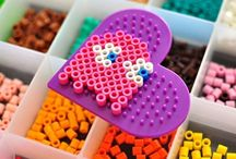 Hama beads are scattered everywhere