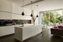 Kitchen Architecture bulthaup case study - Family entertaining space / b3 furniture in apline-white laminate with graphite laminate flashback. A luxurious contrasting open plan family living space.