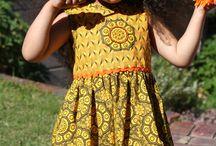 JenniDezigns Clothing - SS17 Catalgoue / Girls ShweShwe African Print Dresses & clothing  . Handmade in South Africa www.jennidezigns.clothing #ShweShwe #GirlsPrintDresses #GirlsAfricanPrint #KidsPrintFashion
