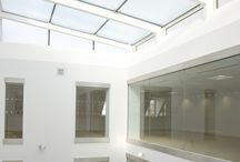 Point Fixed Glass Rooflights / Point fixed rooflights provide a totally transparent glass structure and use stainless steel fittings to bolt the system in place.