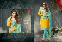 Sangam / Beautifully Designed Georgette Jacquard Salwar Suit with fine embroidery work done all over along with Contrast matching Cotton Bottom and Chiffon Duppatta.