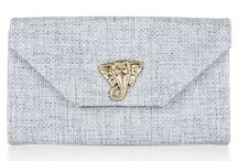 W&G Paddy / THE 'PADDY' CLUTCH BAG The 'Paddy' is a slightly smaller version of the 'Wallace' envelope bag. It has a side and base gusset, two inner pockets and a gold chain so you can carry the bag as a clutch or over your shoulder. Finished with a gold plated brass elephant, this season it is available in four different colours.