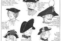 Pánské dobové klobouky a účesy