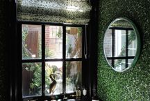 Terrace Viewing Garden / A long and linear wrap-around terrace of an upper floor Greenwich Village apartment was turned into a lush and timeless urban oasis. An intricate composition of faux foliage materials, of ferns, vines, evergreens with willow fences, not only soften the rectilinear edges and conceal outdoor utilities, but also complement the minimalist interior design elements.