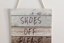 This Shoes off please sign has lots of 5 Star Reviews, can be custom made with your own personal message.
