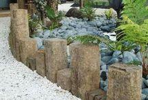 river rock slope garden