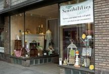 Sensibilities Downtown / Sensibilities Downtown is located in the historic Castanea Building in the heart of our vibrant community, surrounded by restaurants, shopping, theaters, museums and galleries. Several area hotels are within a few blocks including Hotel Indigo, the Aloft, Haywood Park and the Renaissance. The many charming B&Bs of the Montford area are also within walking distance. The historic space occupied by Sensibilities Downtown retains its stamped tin ceiling, wood floors, exposed brick and copper fram
