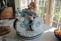My Diaper Cakes / I quite enjoy making diaper cakes. If you live in the Atlanta area, let me know and I can help make your next shower spectacular! Each diaper cake is made out of Size 1 Pampers diapers and can range from 80-150 diapers!  / by Julie Mervich Feicht