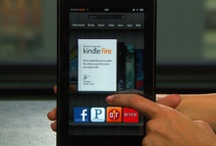 Kindle Fire & iPhone  / by Holly Woodcock