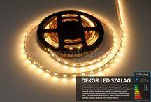 2015. ősz - Új LED szalagok az ANRO webáruházban / 2015. őszén 10-féle LED szalaggal bővült kínálatunk!   Vannak közöttük egyszerű fehér fényű csíkok a színváltóson át az olyan típusig, amely egyszerre van felszerelve RGB és Fehér LED chipekkel.  Hangulatvilágításhoz, rejtett világításhoz, gipszkarton dekorációhoz, de akár fővilágításhoz is alkalmasak az egyes típusok, így már 70-féle LED fénysorból válogathat, ha ilyen világításban gondolkodik!  LED világítással kapcsolatos kérdés esetén keresse fel webáruházunkat a www.anrodiszlec.hu címen!