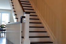 Parr Project / Stunning new stair constructed with Steamed Beach treads, white painted stringers and risers, Lampton style Birch handrail, 5 1/2''  custom posts with trim and cap painted white and white 1 1/4'' square spindles