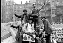 B- boys / In the early 70's Dj Kool Herc would play the 'breaks' of songs. Meaning, he would only play parts of the songs where it was beat only, no lyrics. This would excite the people to dance. So in turn girls and guys who danced to these 'breaks' were called 'Break Boy and Break Girl' or 'B-Boy; B-Girl' in short.