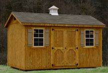 Wooden Storage Buildings / A collection of pressure treated wooden storage buildings.