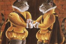 Artistic cats- drawn, painted and dressed up