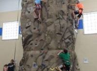 Fun Features / Climb to new heights on our rock climbing wall open Saturdays through August 26 from 10-11:30 am and swim, bounce and play on our WIBIT open on select Saturdays from 11:30-1:30 pm (August 19 is the next open play).