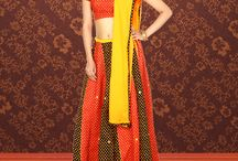 Traditional Tales / Presenting a poetry of vibrant colors, fascinating patterns, and enchanting designs through this extended range of designer lehengas.  / by Rajrang