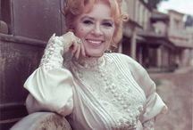 """Miss Kitty / When I was a little girl I watched """"Gunsmoke"""" on tv everyweek just to see what Miss Kitty was wearing! She could be lost, kidnapped or held hostage but her hair and make up were perfect! / by Angela Boggs"""
