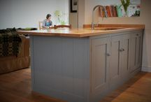 Cosy Shaker Kitchen in Kemble / This Cotswold stone house in Kemble was the location for a small but surprisingly spacious and cosy Shaker kitchen.  Having knocked down the internal walls to create an open plan living space for themselves and their two sons, Ben and Lou wanted to keep the number of cabinets down to a minimum whilst retaining ample storage for the family.  We built an enormous larder cabinet enabling the entire remainder of the kitchen to consist of an island and two range side cabinets.