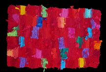 Rag Rugs, hand made in America / Abandoned clothing takes on a new life.  The rugs on this board have been created by hand from recycled t shirts and other old clothes.  For more information, visit www.rugsfromrags.com. Good news bad news:  the rugs are off the market, pending release of my next book....  (they're needed for the photography).