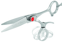 Hair Shears / Revolve Shears - Made exclusively for the salon professional, each pair of shears is an exploration in design and engineering. Forged from Japanese Hitachi molybdenum alloy, the highest grade of steel, every production of these shears involves more than 100 hand processes. From the distinctive pliable thumb that encourages ergonomic hand and arm positioning to the exaggerated offset that reduces hand and thumb fatigue.