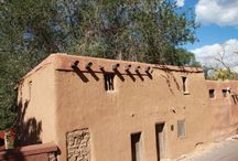 Pueblo Architecture of Northern New Mexico / Adobe pueblos are Native American house complexes used by the Pueblo Indians of the Southwest. The pueblos are modular, multi-story houses made of adobe or of large stones cemented together with adobe. Each adobe unit is home to one family, like a modern apartment. The whole structure, which can contain dozens of units, was often home for an entire extended family.