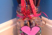 DIY mason jar makeup brush holder!♡ / DIY mason jar valentines day makeup brush holder idea!  Steps:  1:gather materials such as mason jar, beads of choice,yarn,ribbon,paper,and makeup brushes if you want you can have the clips as shown in the photo! 2:pour the beads in 3:trace a heart on you paper and cut it out! 4:color the heart in 5:put ribbon and yarn at the top and put any decorations of your choice!  That's it and then just put your makeup brushes in and you have completed this simple valentines day DIY!  Xoxo,megan