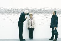 A measurement can be artistic / It's only white wall but with many sign of height of human body make it look artistic.