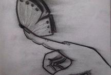 Mariposa en mano