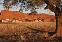 Namib Desert Lodge / The main building and the chalets of Namib Desert Lodge are spread out along the foot of the fossilised dunes of the ancient Namib. A comfortable sojourn is guaranteed by 65 en suite rooms with air conditioning. A restaurant and bar, an inviting terrace with views of the fossilised dunes and two swimming pools beckon you to linger and relax. Oryx antelope and springbok make frequent appearances at our illuminated watering place.