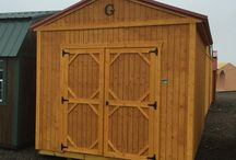 "Utility Shed / Our Utility Sheds come with many features, including:  *Pressure treated 4"" x 6"" Support Beams  *Pressure treated 5/8"" flooring  *Pressure treated 2"" x 6"" Floor Joists  *Standard wall height 92"" *8' x 12' Has 48"" Single Wood Door *Double Wood Door (72"" x 69"") opening on 10' wide and larger *Soffit vents *Douglas Fir Siding"