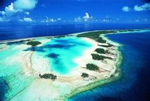"""DISCOVER: Rangiroa / Rangiroa, a one-hour flight from Tahiti, is the world's second largest atoll. From the air it appears as a large pearl necklace gently placed on the water. Known as """"The Infinite Lagoon,"""" Rangiroa's coral ring creates a seemingly endless display of deep turquoise and lapis blue. Because there's no island runoff, the visibility in the lagoon is over 150 feet and the temperature a constant 80 degrees."""