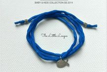 The Little League - Baby & Kids Collection SS/ 2014 / 100% Pure silk wrap bracelets adorned with silver accessories, sandalwood beads and silver-plated pendants.